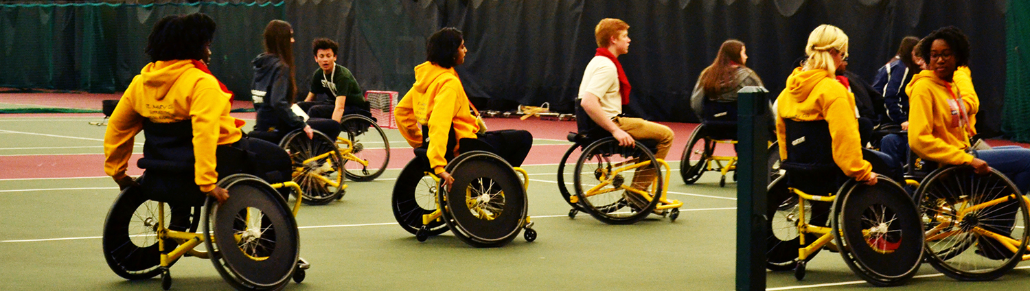 Youth participating in wheelchair sports