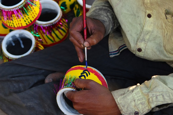 image of someone painting a pot