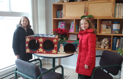 Tyler and Danielle with their festive cat house creations