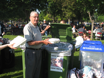 Man sorting his garbage into appropriate bins