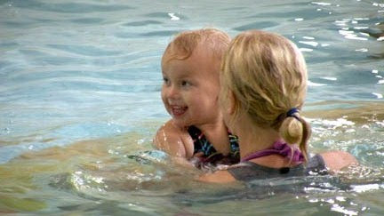 woman and toddler swimming