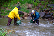 men participating in a salmon release