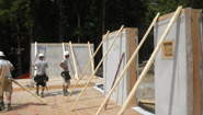 construction workers working on a strawbale house