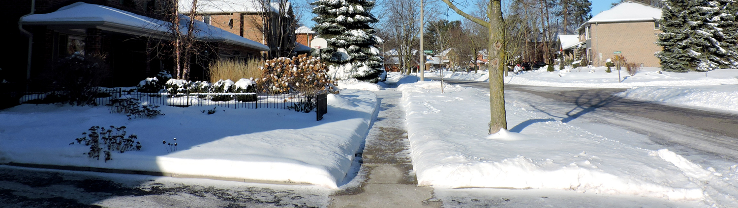 Residential area sidewalk in winter